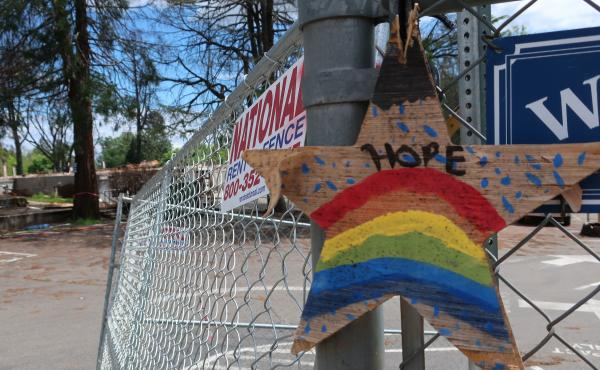 A homemade sign hangs on the fence surrounded Paradise Elementary School. The school was destroyed by the fire and the rubble is now being bulldozed and cleaned up.