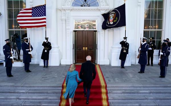President Biden and first lady Jill Biden walk up the stairs as they arrive at the North Portico of the White House on Wednesday.