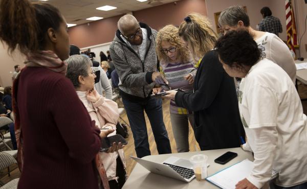 Nevada caucus volunteers receive training for recording results Thursday in Las Vegas.