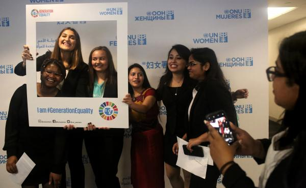A lighter moment on a serious day: the presentation of a Global Girls' Bill of Rights at the U.N. Left to right: Six of the young women who helped draft the document: Faith Nwando, 17; Djellza Pulatani, 17; Olivia Lombardo, 16; Angelica Morales, 21; Kanch