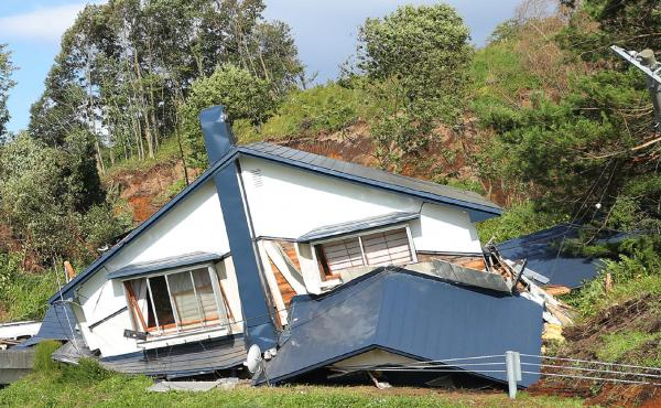 A house is damaged by landslides caused by an earthquake in Atsuma town in Hokkaido prefecture on September 6. A 6.7-magnitude quake rocked the northern Japanese island of Hokkaido.