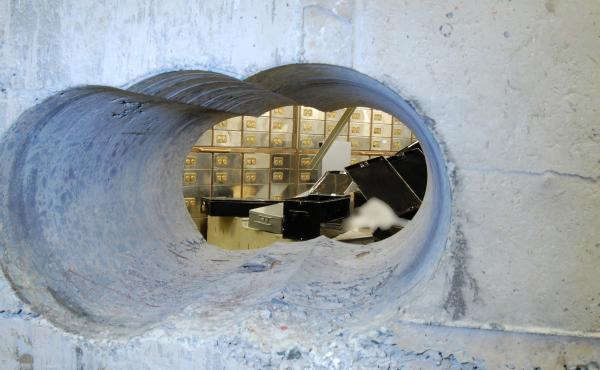 This image, supplied by the Metropolitan Police, shows a view of the hole drilled in the vault wall at Hatton Garden Safe Deposit Ltd. following the Easter weekend robbery last year in London. Millions of dollars worth of jewels, cash and other valuable i