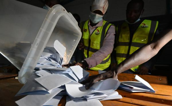 Niger's Electoral Commission workers count the ballots at a polling station during Niger's presidential election runoff in Niamey on Sunday. In the country's west, a vehicle carrying poll workers struck a landmine, killing seven and seriously wounding thr