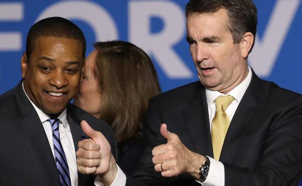 Virginia Gov.-elect Ralph Northam (right) and Lt. Gov.-elect Justin Fairfax greet supporters at an election night rally Tuesday after the Democrats' victory.