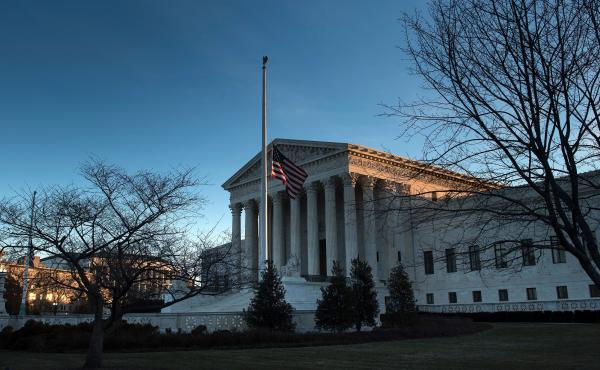 An American flag flies at half staff outside the U.S. Supreme Court after the death of Justice Antonin Scalia. The fight to replace him could be historic, resulting in the longest vacancy in history.