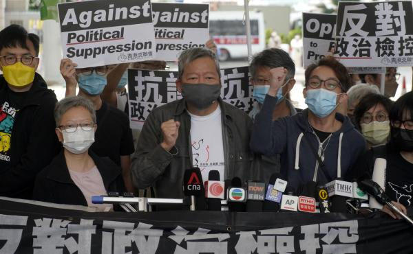 Pro-democracy activist Lee Cheuk-yan, center, arrives at a court in Hong Kong Friday.  Seven of Hong Kong's leading pro-democracy advocates, including Lee, and pro-democracy media tycoon Jimmy Lai, were sentenced Friday for organizing a march during the 2