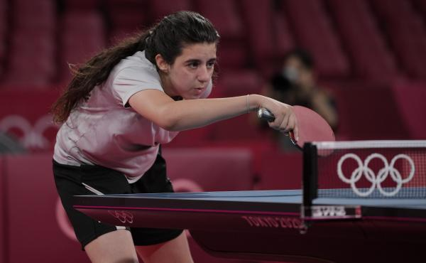 Syria's Hend Zaza competes during a women's table tennis singles preliminary round match against Austria's Liu Jia at the Summer Olympics in Tokyo.