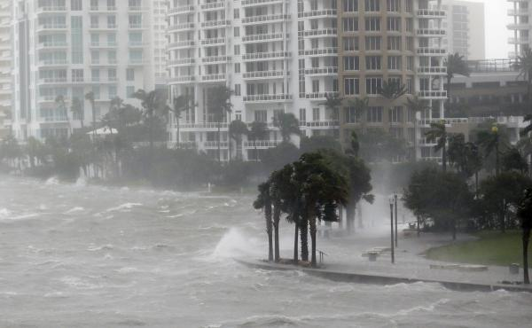 Hurricane Irma sends a storm surge crashing over a seawall at the mouth of the Miami River in Florida. The Army Corps of Engineers is proposing a network of more sea walls, gates and other barriers to protect the Miami waterfront from storms and hurricane