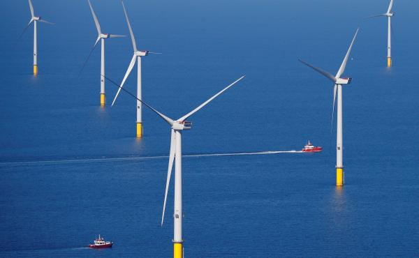 A support vessel is seen next to a massive wind turbine at the Walney Extension offshore wind farm operated by the Orsted energy company off Britain's west coast on Sept. 5.