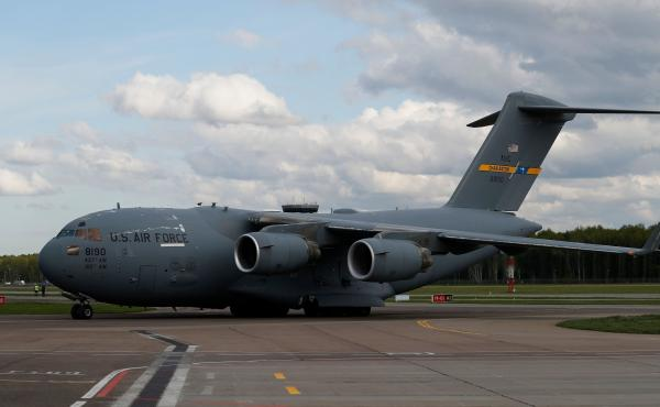 A U.S. Air Force C-17 Globemaster transport plane carrying medical supplies lands in Moscow in May 2020. The same type of plane airlifted refugees from Afghanistan this past week — one of whom gave birth on the aircraft.