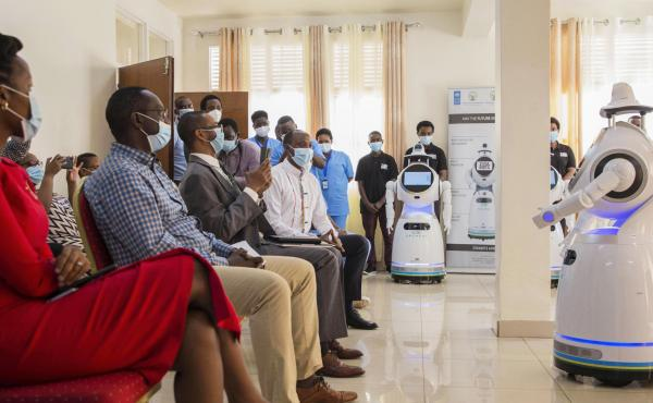 A robot introduces itself to patients in Kigali, Rwanda. The robots, used in Rwanda's treatment centers, can screen people for COVID-19 and deliver food and medication, among other tasks. The robots were donated by the United Nations Development Program a