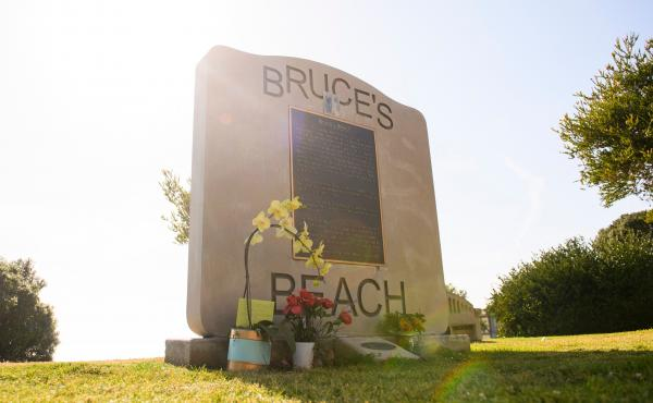 Flowers in support of the Bruce family and George Floyd stand at Bruce's Beach in April in Manhattan Beach, Calif.