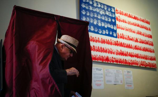 A man casts his ballot at a polling station in Hoboken, N.J., during New Jersey's primary elections June 7.