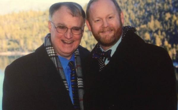 Larry Dearmon (left) and Stephen Mills pose on their wedding day at Lake Tahoe in 2013.