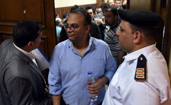 Egyptian human rights activist Hossam Bahgat (center) leaves a Cairo courtroom on Wednesday after a hearing in which the state requested a travel ban and freeze of his assests. The government has taken action against a number of groups and activists in wh