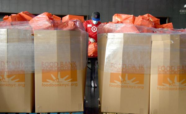 New Yorkers in need receive free produce, dry goods and meat at a Food Bank For New York City distribution event on July 30, 2020.