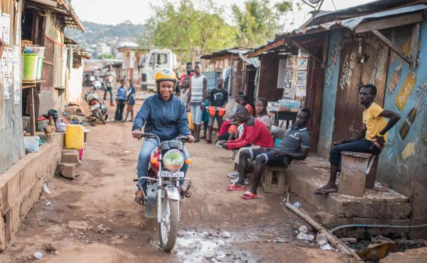 Mariatu Kamara is a former prostitute who was trained to become a motorbike taxi driver. Despite police harassment and restrictions on where taxis can operate, she is determined to make her new life work.