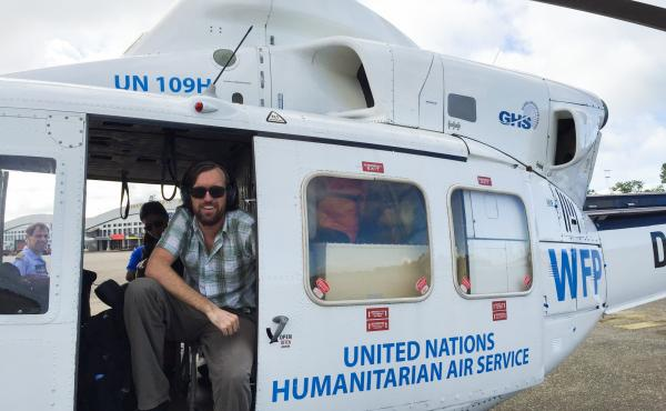 Dr. Eugene Richardson in a helicopter during the Ebola outbreak in Sierra Leone, where he worked as a clinical lead for Partner in Health's response to the outbreak. He is the author of the new book Epidemic Illusions: On the Coloniality of Global Public