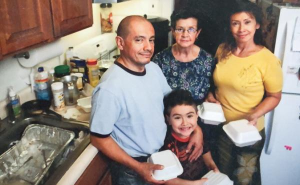 The Muñoz family (from left: Jorge, Justin, Blanca and Luz) prepares meals from their kitchen in 2010.