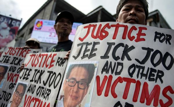 Activists protest at the headquarters of the Philippine National Police, condemning the government's war on drugs and holding placards showing murdered South Korean businessman Jee Ick-joo. The South Korean businessman was allegedly kidnapped by Philippin