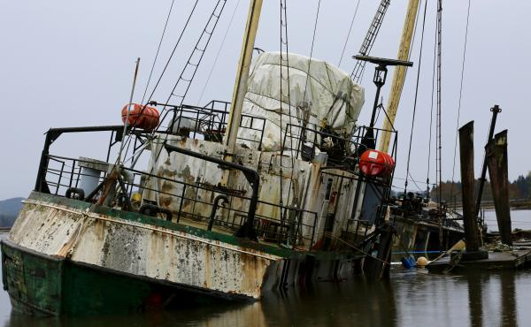In its prime, the Hero sailed through frigid temperatures and ice-strewn waters in the South Pole. But now it's sinking, leaking oil and threatening Washington's oysters.