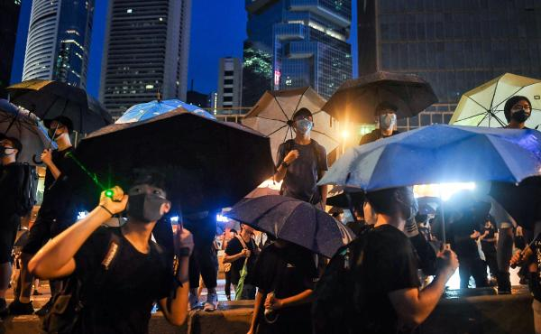 Protesters gather for a rally Sunday in Hong Kong. Many of the pro-democracy demonstrators have brandished umbrellas in a nod to a symbol widely used during the semiautonomous city's massive 2014 protests.