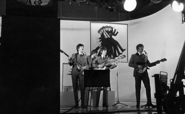 The Beatles perform one of their songs while filming A Hard Day's Night in 1964.