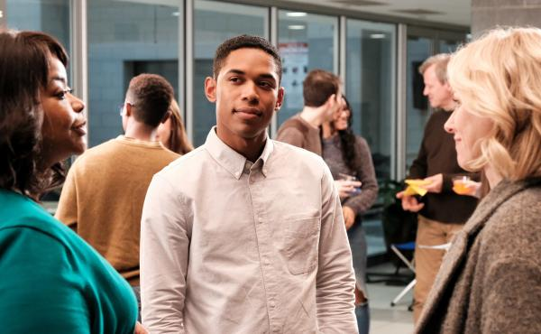 Kelvin Harrison Jr. (center) plays a former child soldier who lives with his adoptive family in Virginia and winds up in conflict with his high school history teacher (Octavia Spencer, left) and adoptive mother (Naomi Watts).