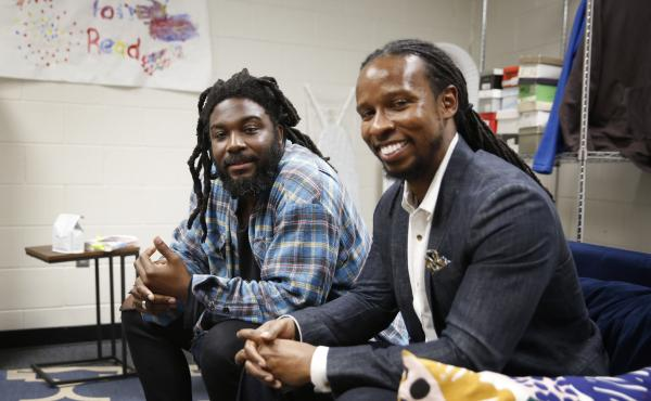 Authors Jason Reynolds, left, and Ibram X. Kendi spoke to students at a high school in Washington D.C. about their new book, Stamped: Racism, Antiracism and You.