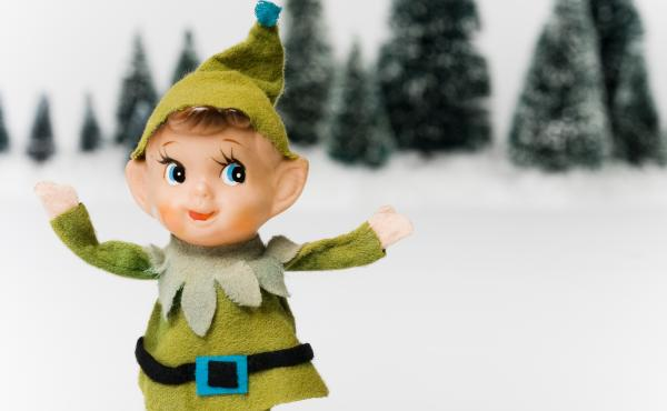 An elf with snow and trees