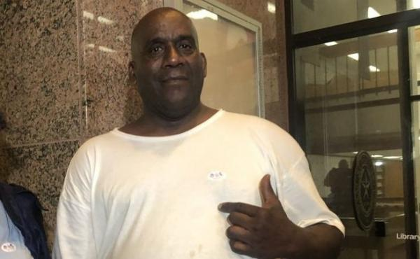"""Hervis Rogers points to his """"I voted"""" sticker on Super Tuesday in 2020. This week he was arrested for allegedly voting while on parole, which is illegal in Texas."""