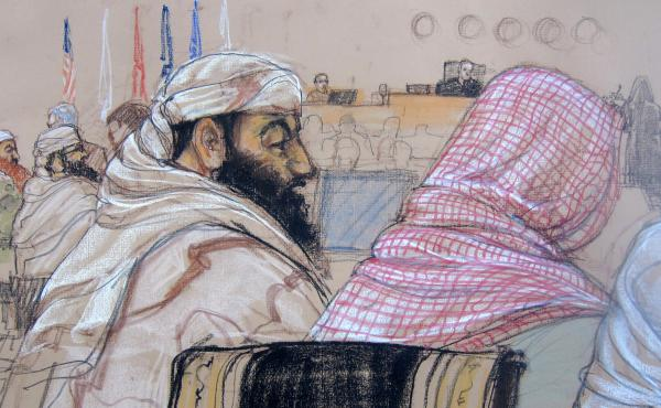 In this Pentagon-approved courtroom sketch, defendant Ramzi Binalshibh (center) attends his pretrial hearing along with other defendants at the U.S. military court in Guantánamo Bay, Cuba, on April 14, 2014. Also depicted are Mustafa al-Hawsawi (from rig
