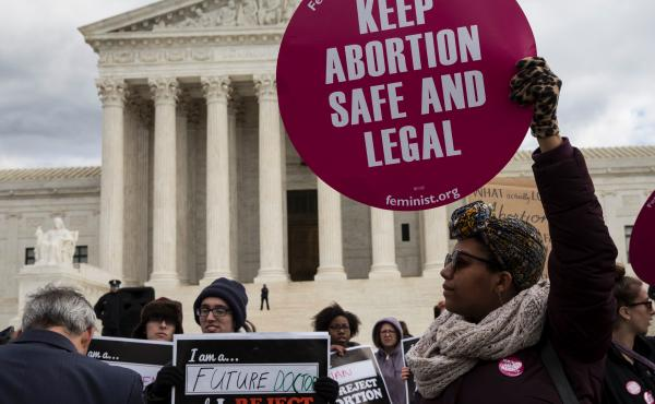 Abortion rights supporters and opponents protest outside the U.S. Supreme Court on January 27, 2017. The issue of abortion will spark millions of dollars in spending on advocacy for and against President Trump's Supreme Court nominee.