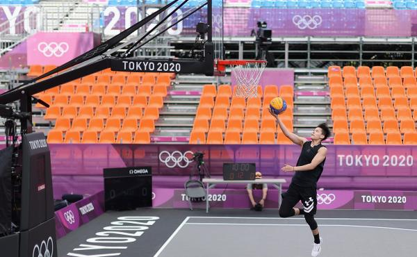 Many Olympic athletes at the Tokyo Summer Games are having to get used to empty stands, the occasional coronavirus quarantine and loneliness. Zhiting Zhang of Team China practices in 3x3 basketball at deserted Aomi Urban Sports Park.