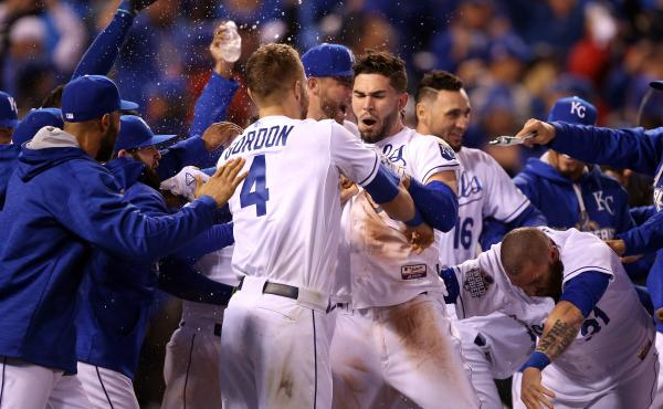 Alex Gordon and Eric Hosmer (center) of the Kansas City Royals celebrate defeating the New York Mets 5-4 in Game One of the 2015 World Series on Tuesday night in Kansas City.