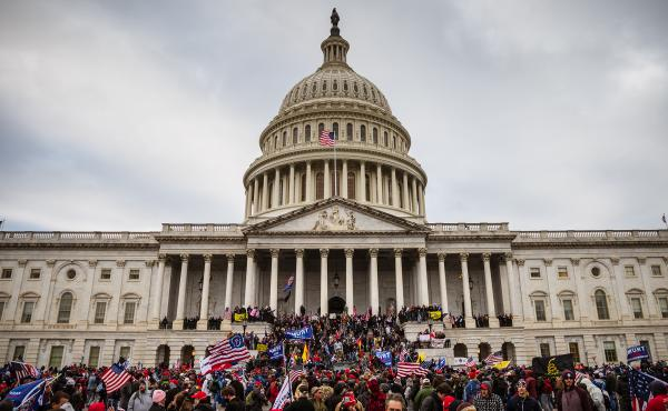 A large group of pro-Trump extremists stands on the east steps of the Capitol after storming its grounds on Jan. 6. A pro-Trump mob stormed the Capitol that day, breaking windows and clashing with police officers to protest the 2020 election results.
