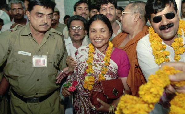"""Phoolan Devi, popularly known as the """"Bandit Queen,"""" received garlands in New Delhi in 1996 after she was elected to parliament. She spent 11 years in jail on charges of murder and banditry, and was released in 1994. She was assassinated in 2001."""