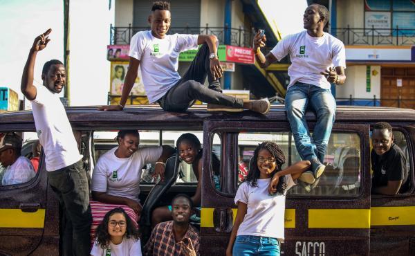 Magic bus team posing on a Matatu van in Nairobi, Kenya.