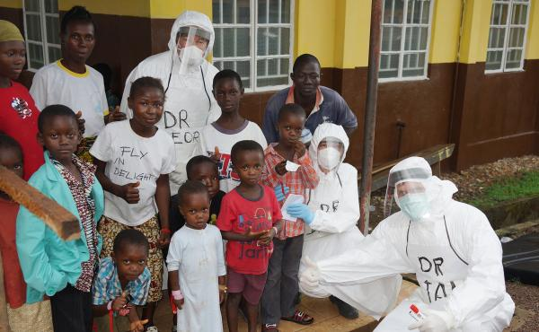 Dr. Risi (top, center) spent a month working with the medical team at Kenema General Hospital, the largest Ebola treatment center in Sierra Leone.