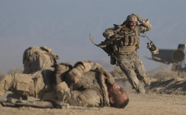 Easy Targets: Matthews (John Cena) and Isaac (Aaron Taylor-Johnson) seek cover in The Wall.