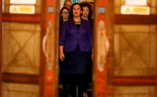 Sinn Fein president Mary Lou McDonald arrives to speak to the media at the Parliament Buildings in Belfast on Feb. 12. She supports same-sex marriage and ending Ireland's abortion ban, but critics warn that she's tied to many of her party's hard-line poli