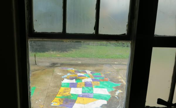 A painted map of the U.S. seen from inside a classroom at Homer A. Plessy Community School, a charter school in New Orleans.