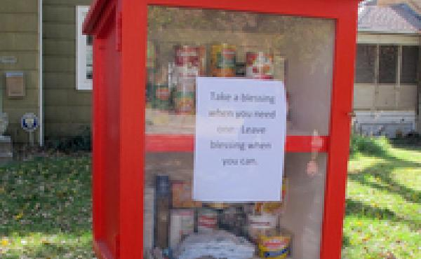 "Nonperishable food is restocked in Maggie Ballard's ""blessing box"" in Wichita, Kan., several times a day."