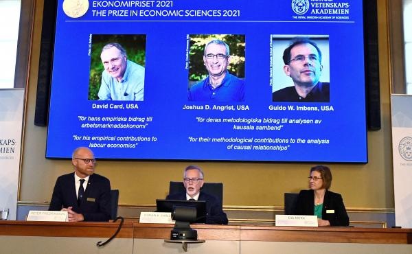 Goran K. Hansson (C), Permanent Secretary of the Royal Swedish Academy of Sciences, and Nobel Economics Prize committee members Peter Fredriksson (L) and Eva Mork (R) give a press conference to announce the winners of the 2021 Sveriges Riksbank Prize in E