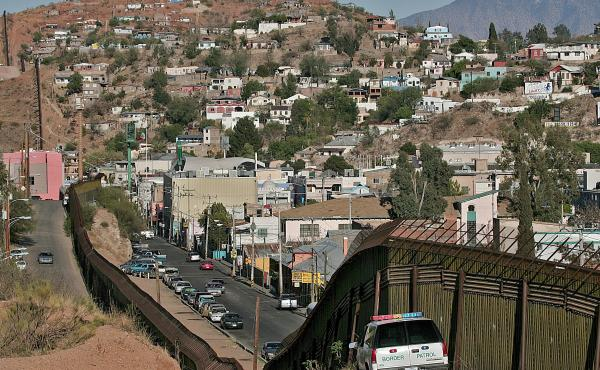 The border fence separating Nogales, Ariz. from Nogales, Sonora, Mexico. In 2012 a Mexican teenager was shot and killed by a border patrol agent shooting through the fence. Last week, the agent was found not-guilty of involuntary manslaughter.