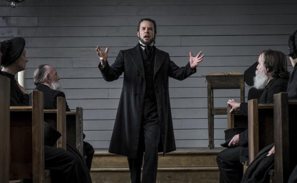 The Spite of the Hunter: Villainous preacher Guy Pearce excoriates his flock in Brimstone.