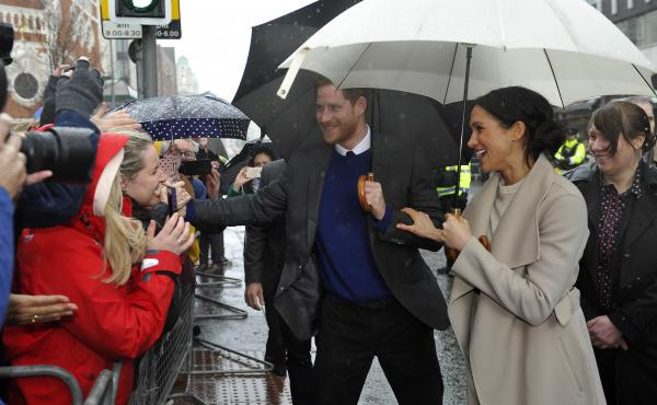 Prince Harry and Meghan Markle greet well-wishers in Belfast, Northern Ireland, in March.