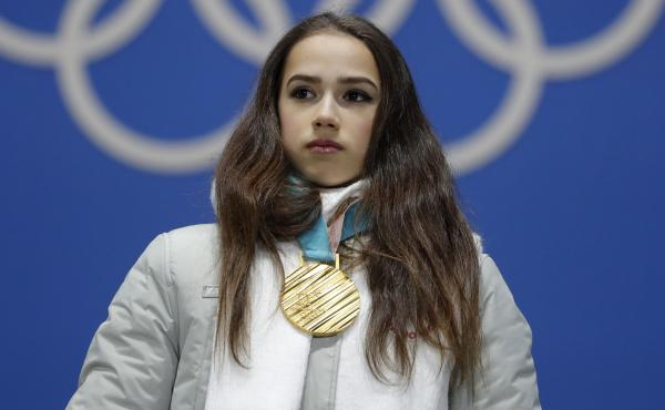 Gold medalist figure skater Alina Zagitova, who competed as an Olympic athlete from Russia, heard the Olympic anthem as she stood on the podium for her medal ceremony.
