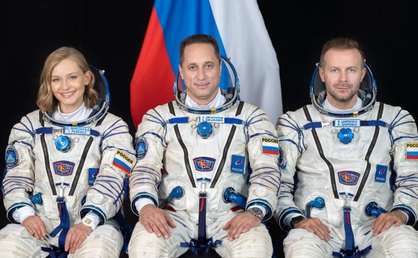 Cosmonaut Anton Shkaplerov (center), along with film director Klim Shipenko (right) and actor Yulia Peresild (left) pose for a photo ahead of the launch of the Soyuz MS-19 spacecraft to the International Space Station from Kazakhstan's Baikonur Cosmodrome