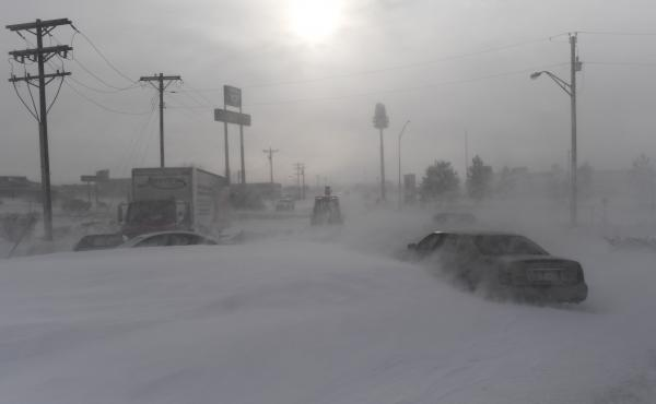 Blizzard warnings have been issued for the Rockies and Plains areas, where a second bomb cyclone is predicted. Here, a man uses a bulldozer to clear snow in Limon, Colo., that was left by a bomb cyclone that swept across much of the state last month.